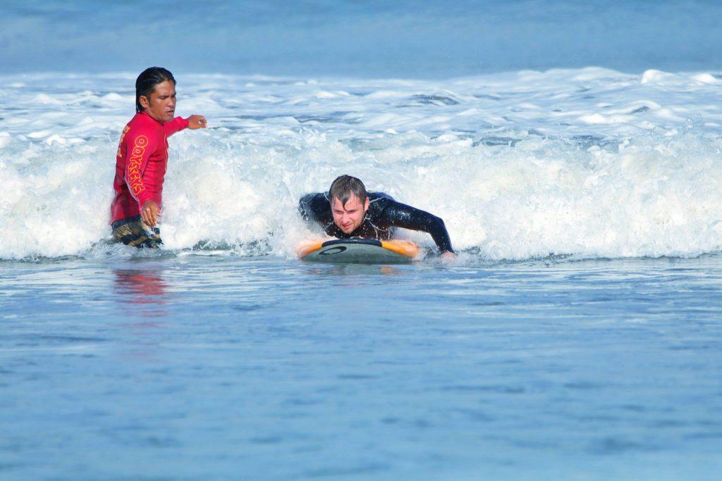 Bali's famous Kuta Beach. Surf, Indonesia